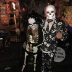 A skeleton couple enters the costume contest.