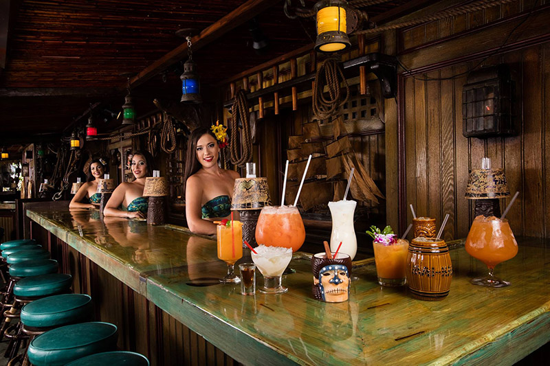 The Molokai Girls show off some of the many cocktails available in the bar in May 2016. (Mai-Kai photo)