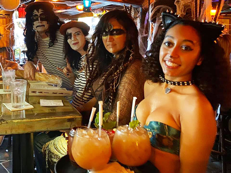 Early arrivals at The Mai-Kai's Hulaween 2019 are treated to great seats and plenty of happy hour cocktails from The Molokai Girls.