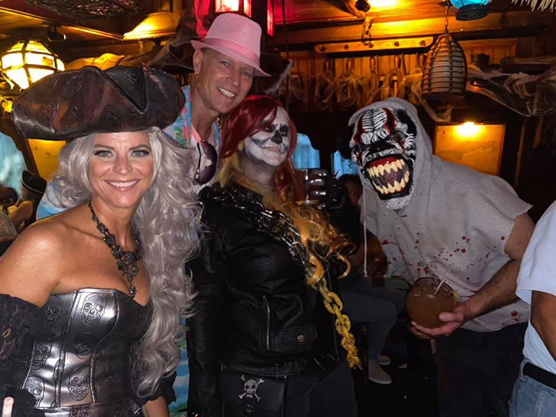 Say cheese! Hulaween partygoers are all smiles.