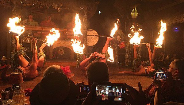 Villagers are enraptured by the Samoan fire dance, the finale of the Polynesian Islander Revue on Saturday night