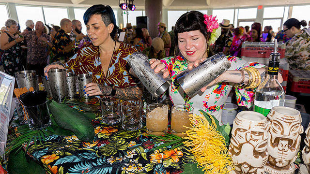 Hale Pele's Sierra Kirk (right) pours cocktails during Thursday's Tiki Tower Takeover