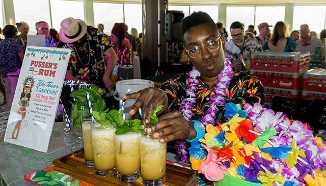 Shannon Mustipher prepares potent Pusser's Rum cocktails at the Tiki Tower Takeover at The Hukilau 2019