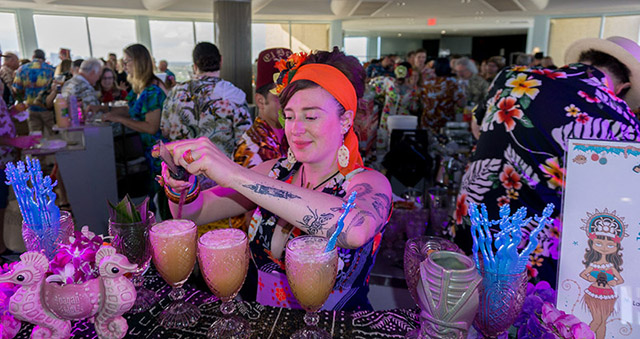 Jeanie Grant of Pagan Idol mixes up cocktails at the Tiki Tower Takeover at The Hukilau 2019