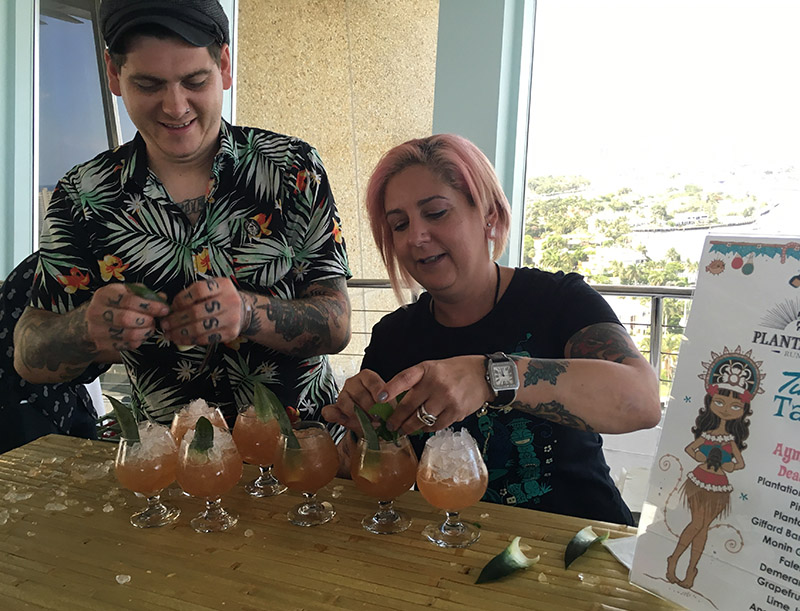 Ayme Harrison prepares cocktails with her Death or Glory bartender Cassidy Moser during the Tiki Tower Takeover at The Hukilau 2019