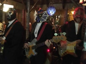 Eddie Angel (left) and Greg Townson (right) perform with Los Straitjackets in The Mai-Kai's Tahiti room during The Hukilau 2018