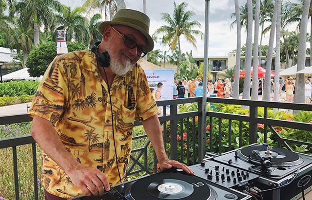 Brother Cleve keeps the tunes flowing at a pool party during The Hukilau 2019