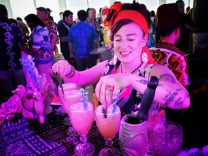 Jeannie Grant of Pagan Idol serves up cocktails during the Tiki Tower Takeover at The Hukilau 2019. (Photo by Hukillau Mike)