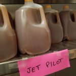 Gallons of the powerful Jet Pilot await labeling.(April 3)