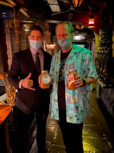Hurricane Hayward is greeted by manager Kern Mattei while picking up quarts of cocktails to go. (Atomic Grog photo)