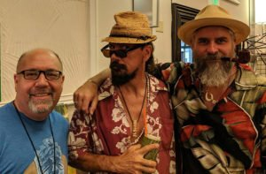 Artists Robert Jimenez (left) and Crazy Al Evans hang out with filmmaker Jochen Hirschfeld (right) in the Tiki Treasures Bazaar at The Hukilau 2019 at Pier 66 in Fort Lauderdale. (Provided by Robert Jimenez)