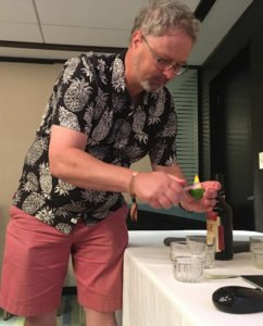 Matt Pietrek demonstrates a flaming garnish during his Okole Maluna Cocktail Academy class at The Hukilau 2019. (Photo by Hurricane Hayward)