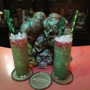 The Atomic Grog's tribute to Blood Island Green Potion #2 (right) alongside the take-home original from The Mai-Kai. (Photo by Hurricane Hayward)