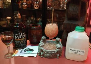 While the restaurant was closed for renovations, we enjoyed a take-home quart of Rum Barrels and a bottle of The Real McCoy 12-year-old Distillers Proof Mai-Kai Blend. (Photo by Hurricane Hayward, November 2020)