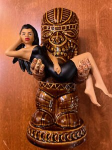 """Forbidden Island's 15th anniversary mug, designed by Brad """"Tiki Shark"""" Parker and produced by Munktiki, is available in two glazes: """"black dress"""" (pictured) and """"red dress."""""""