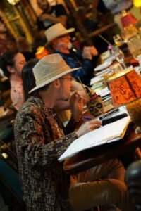 """Hurricane Hayward is hard at work with other judges, including Jeff """"Beachbum"""" Berry, at the Chairman's Reserve Mai Tai Challenge at The Mai-Kai in October 2018. (Atomic Grog photo)"""