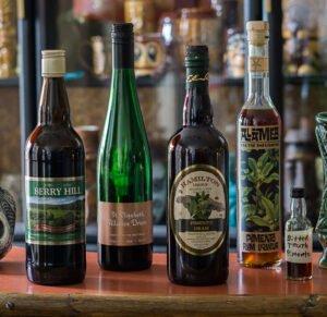 Some of our favorite bottles of allspice (pimento) dram. (Photo by Hurricane Hayward, November 2017)