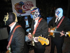 Los Straitjackets perform poolside at the Bahia Cabana during The Hukilau 2009. (Photo by Go11Events.com)