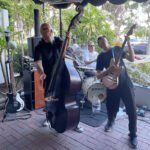 Guitarist Skinny Jimmy Stingray kicks out the jams with bassist Frenchy and drummer Kevin.