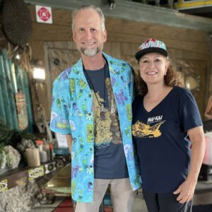 Longtime Mai-Kai owner Mireille Thornton welcomes Hurricane Hayward on Sept. 18 during a special event for guests of The Hukilau. She later led guests in hula dance lessons. (Atomic Grog photo)